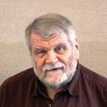 headshot of Dr. Denis Coble